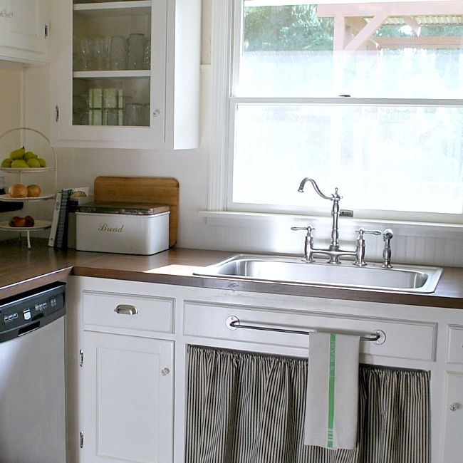 A kitchen with wood counters