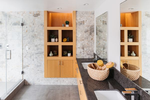 Modern bathroom with decorative tile on walls surrounding wooden shelving
