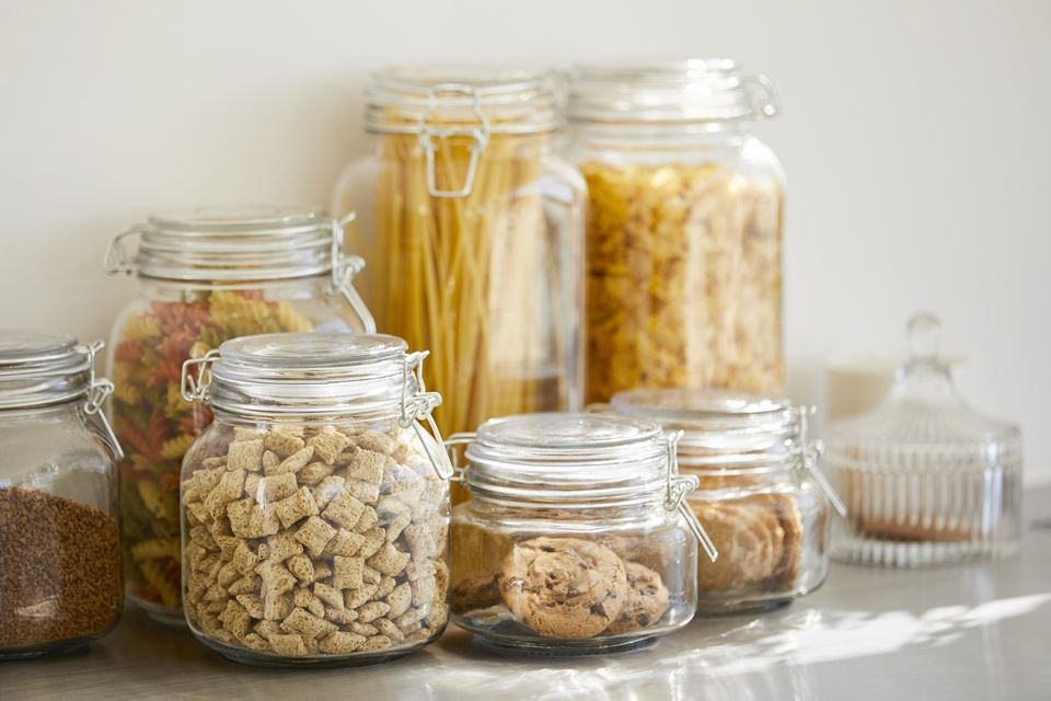 Close-up of various food in airtight jars