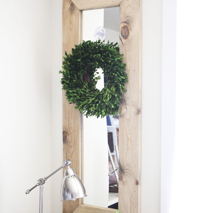 Reclaimed wood mirror diy project with a green wreath over top