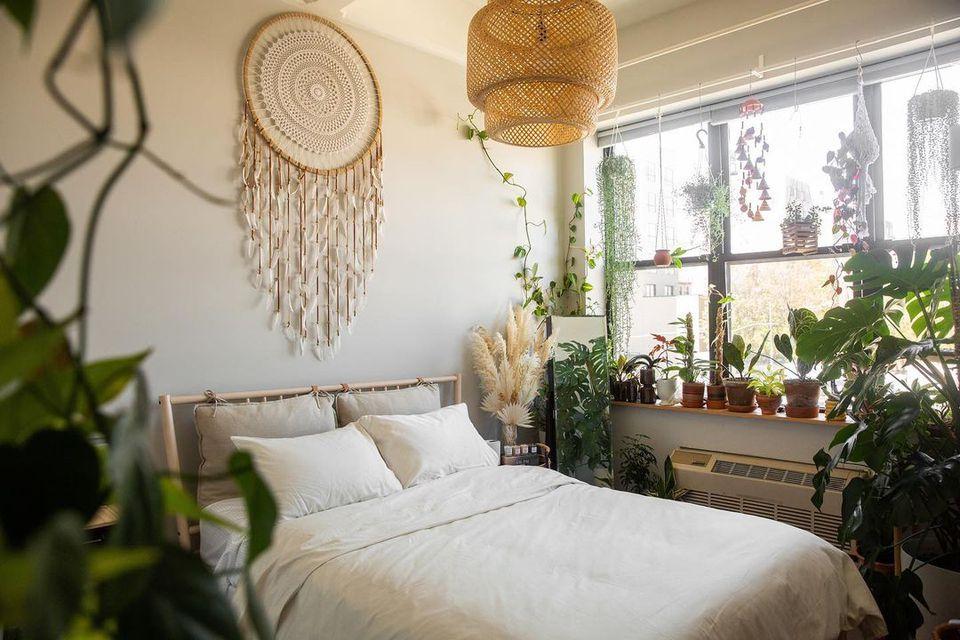 Boho chic bedroom with houseplants and handmade decor items