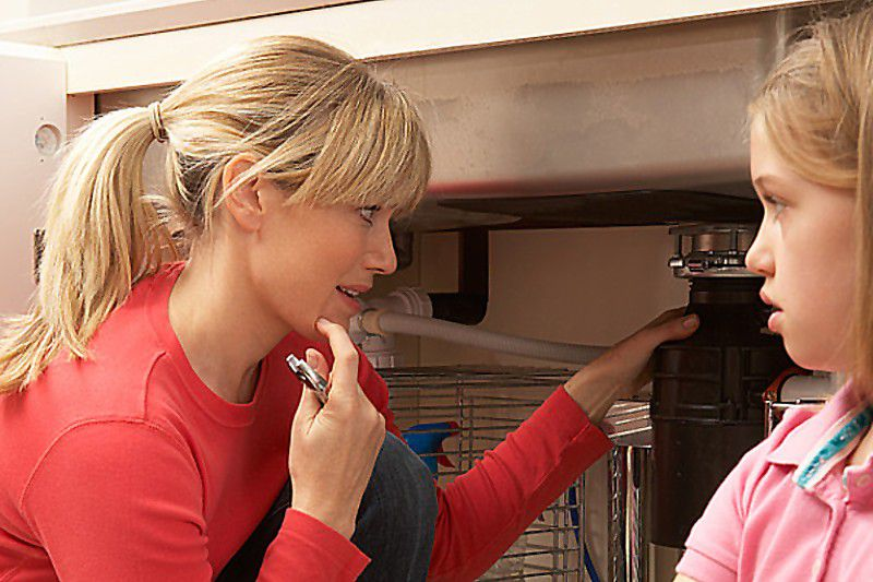 Woman looking at garbage disposal