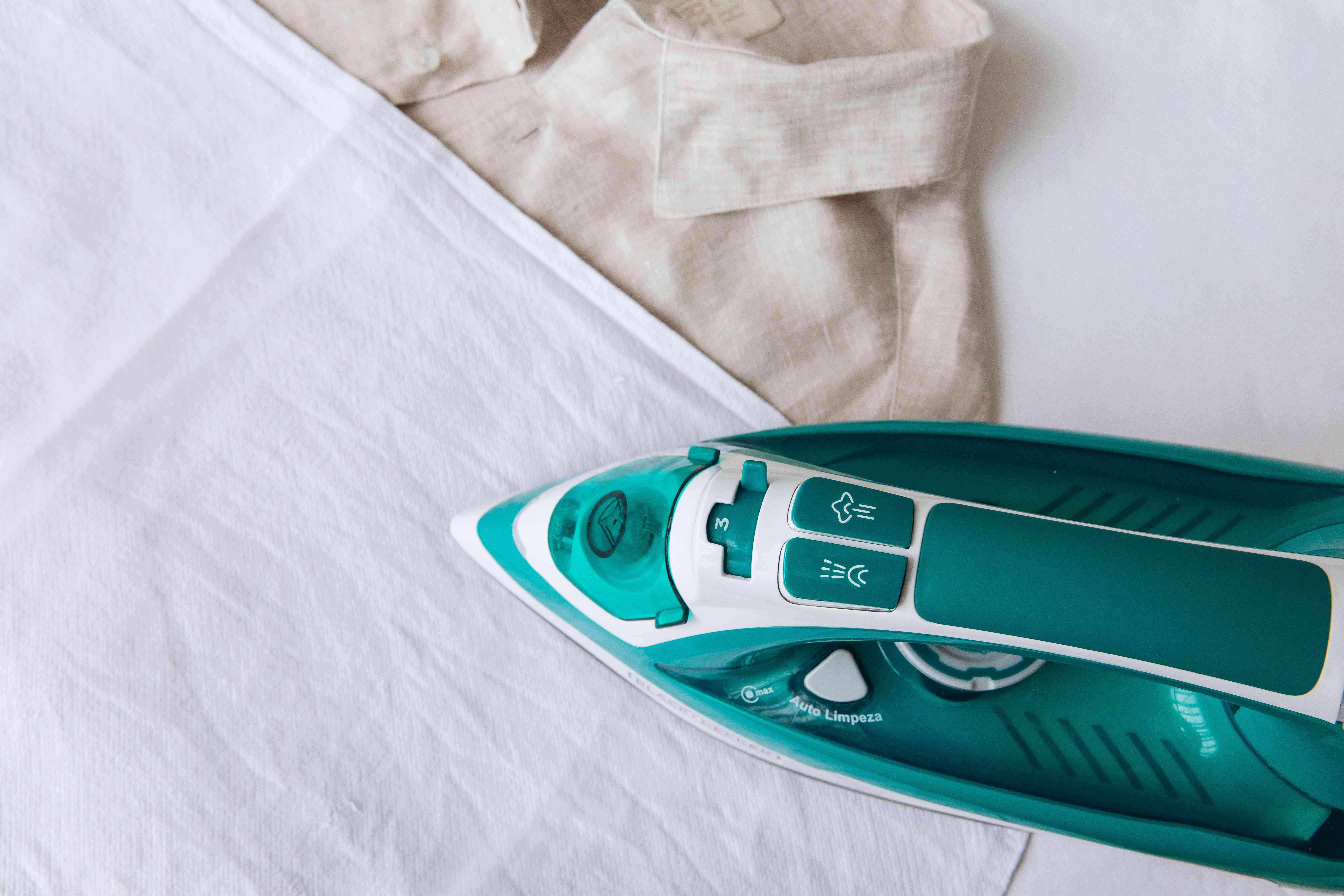 using a pressing cloth to iron a linen shirt