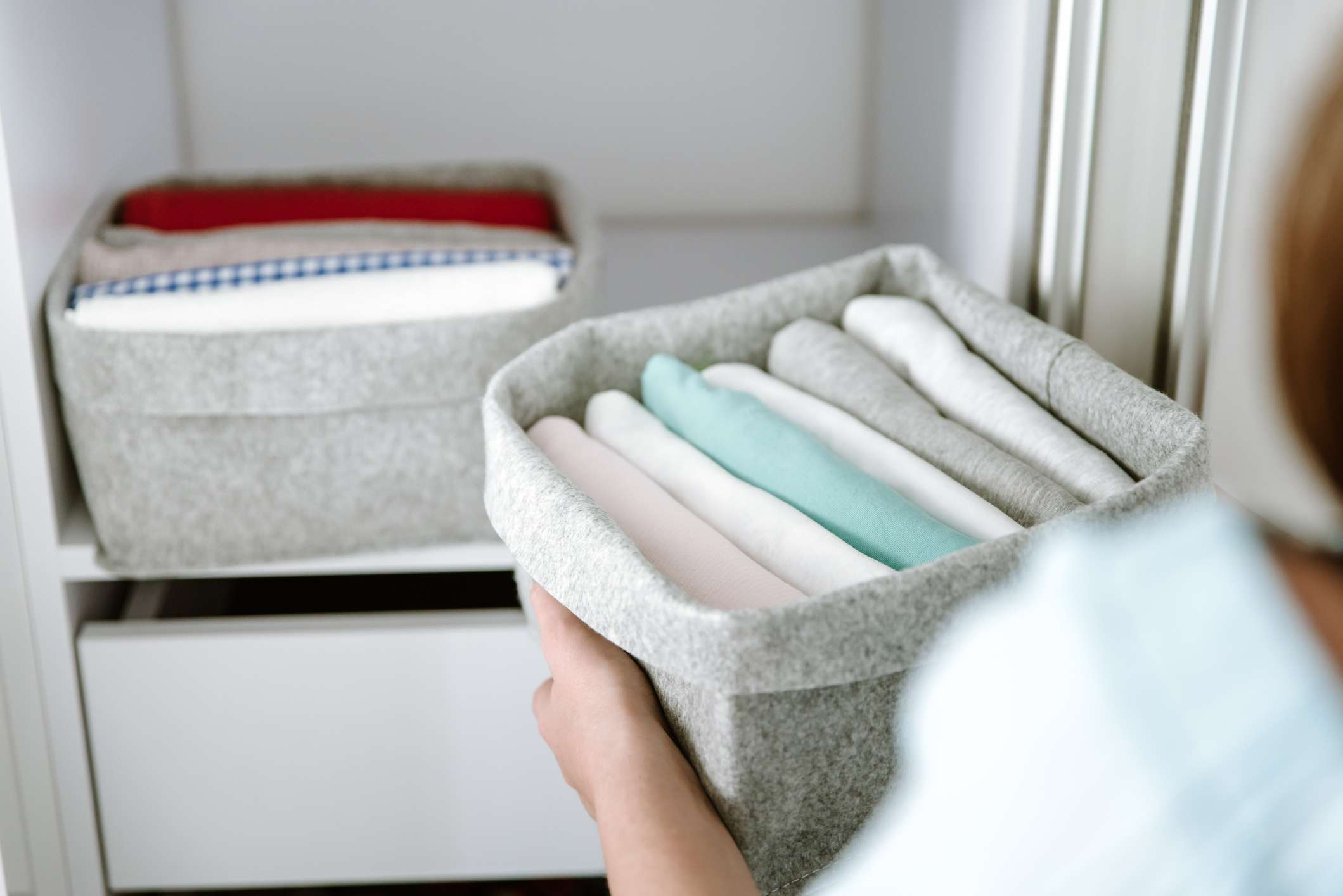 cashmere sweaters folded in a basket