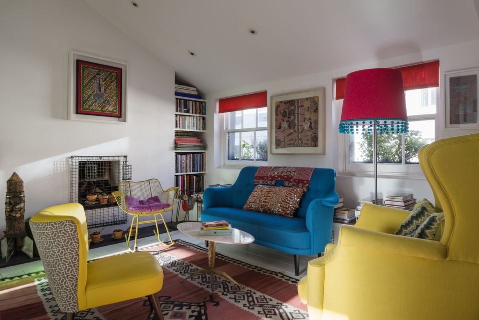 Living room with red, blue, and yellow accents.