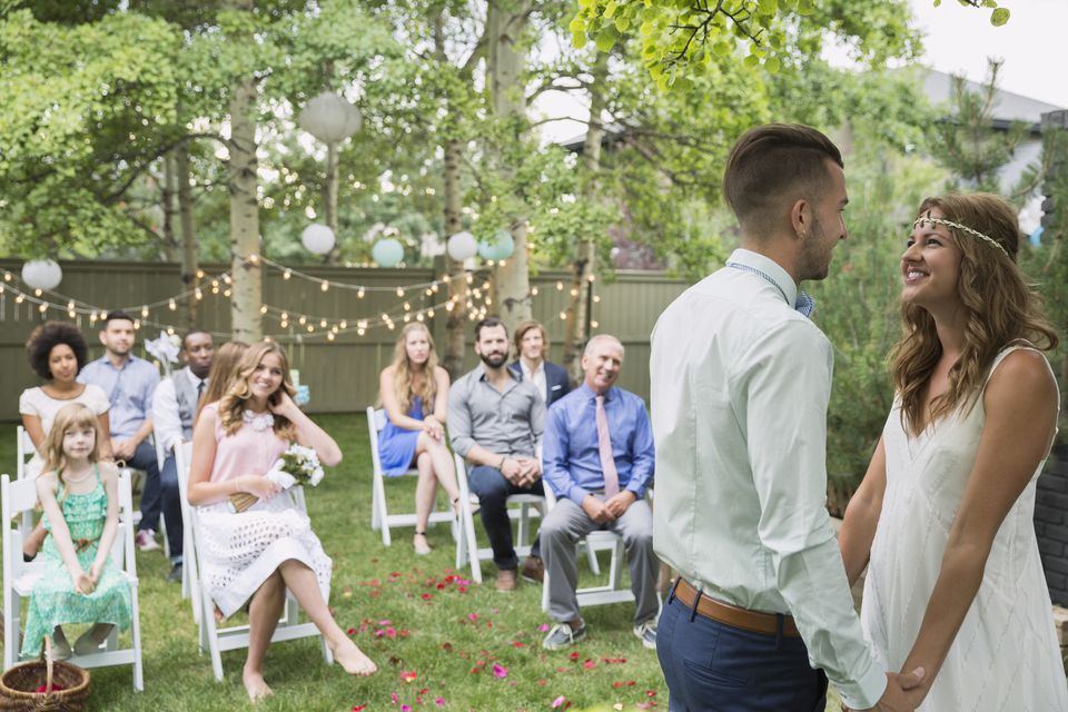 young bride and groom at backyard wedding