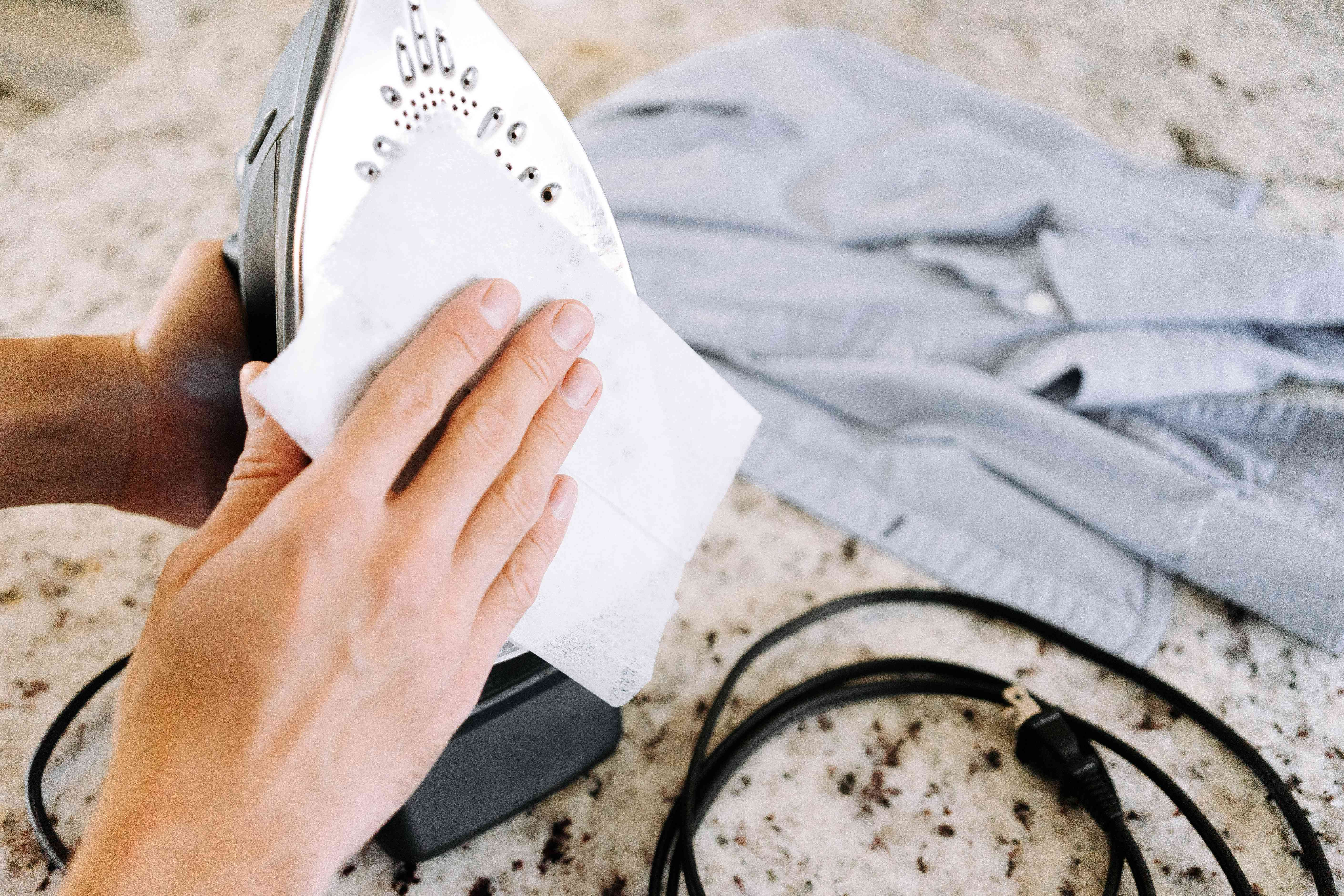 using a dryer sheet on an iron