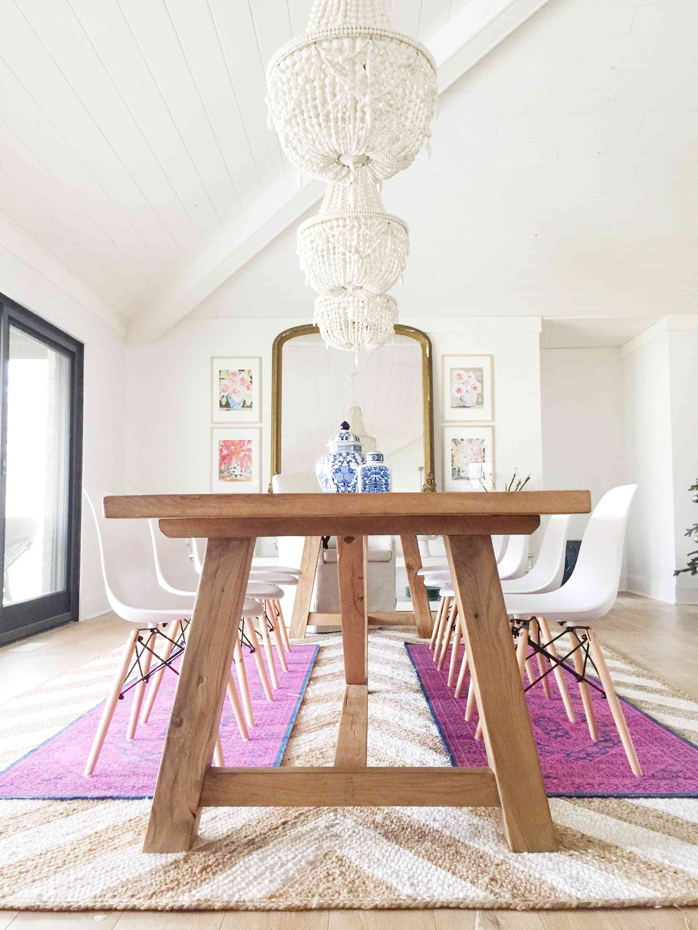 colorful rugs layered over jute in dining room