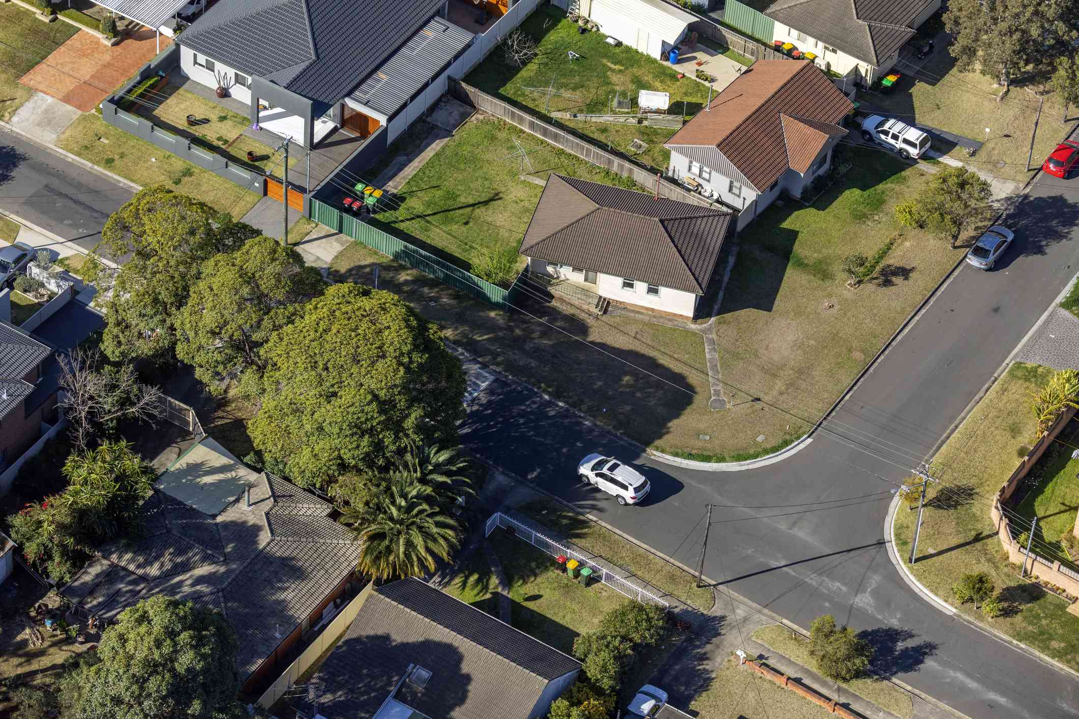 aerial view of a T-intersection in a residential neighborhood