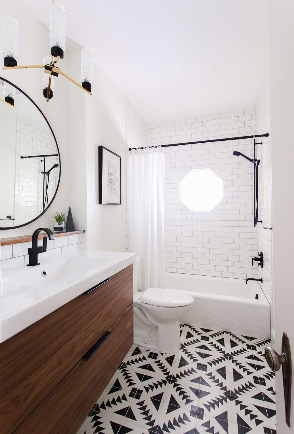 Bathroom with black and white cement tiles