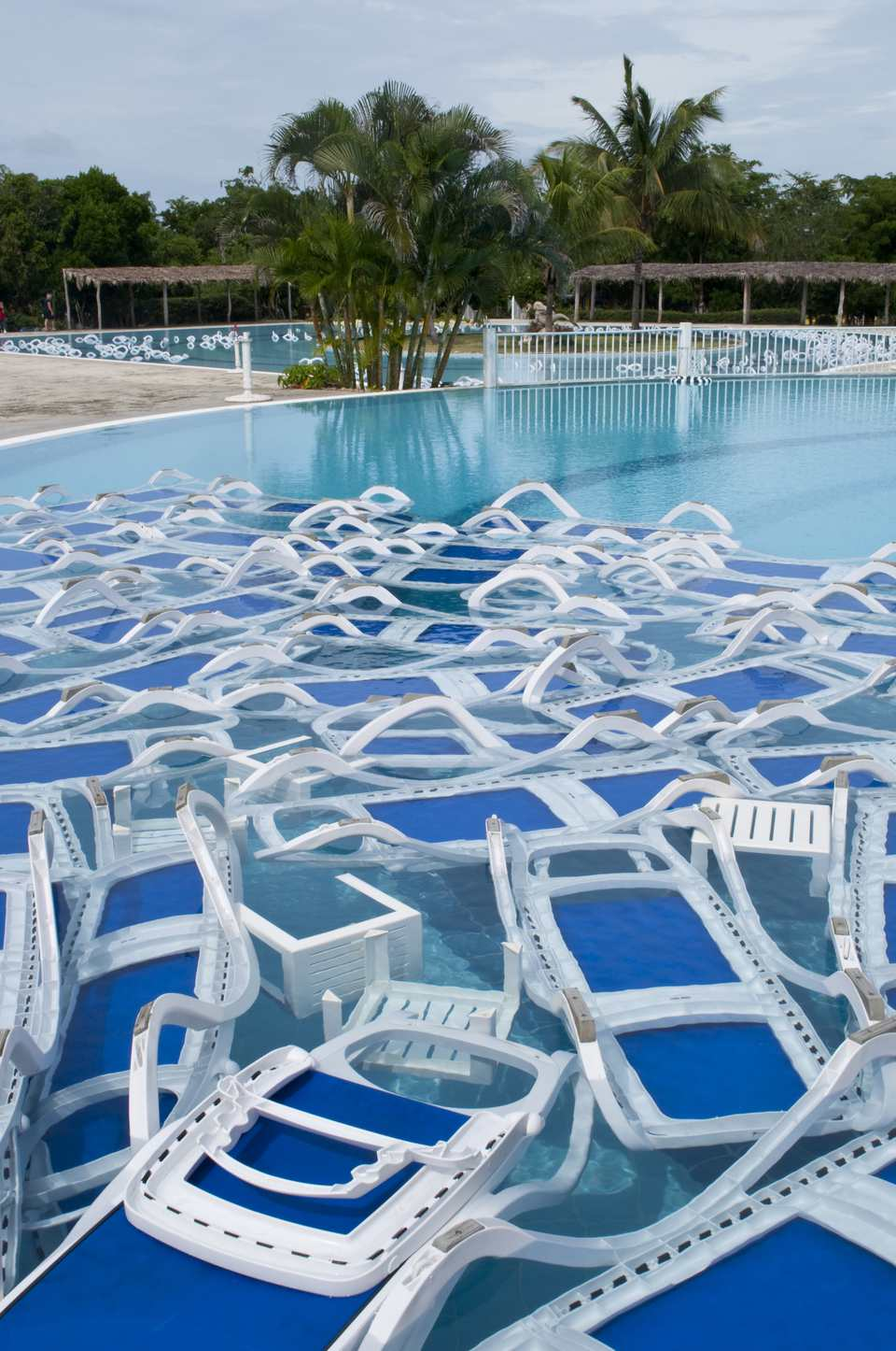 Plastic chairs in a pool