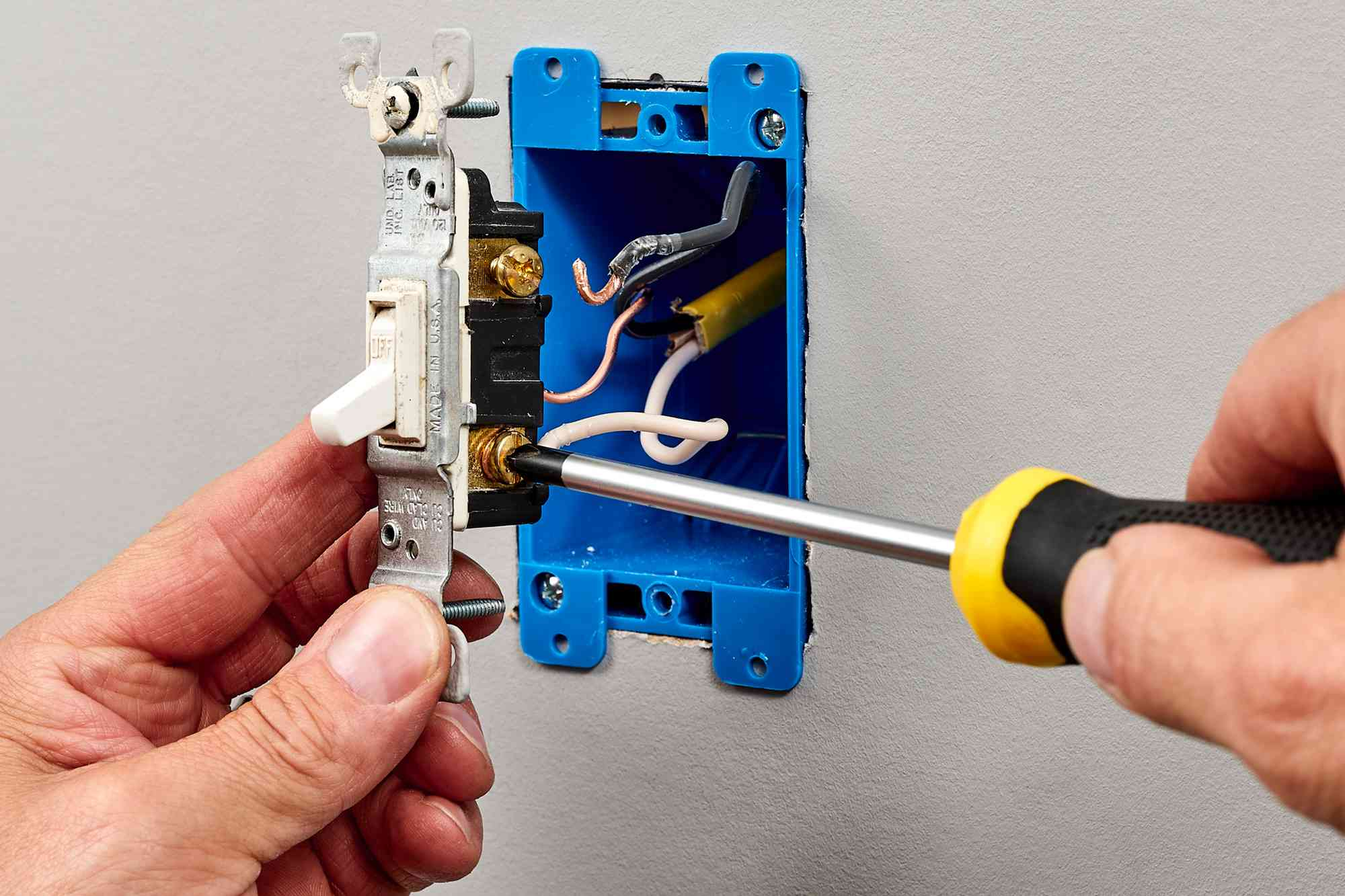 Old switch wiring disconnected by loosening the screw terminal with screwdriver