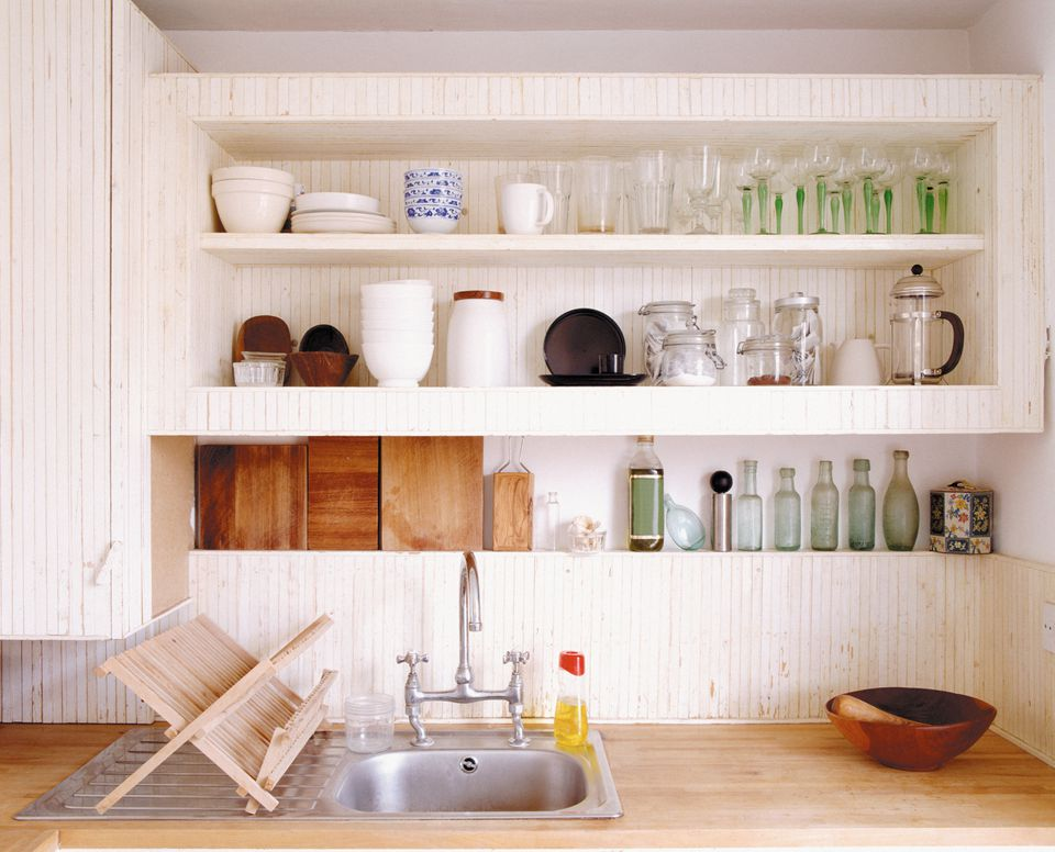 Shelf with dishes over sink