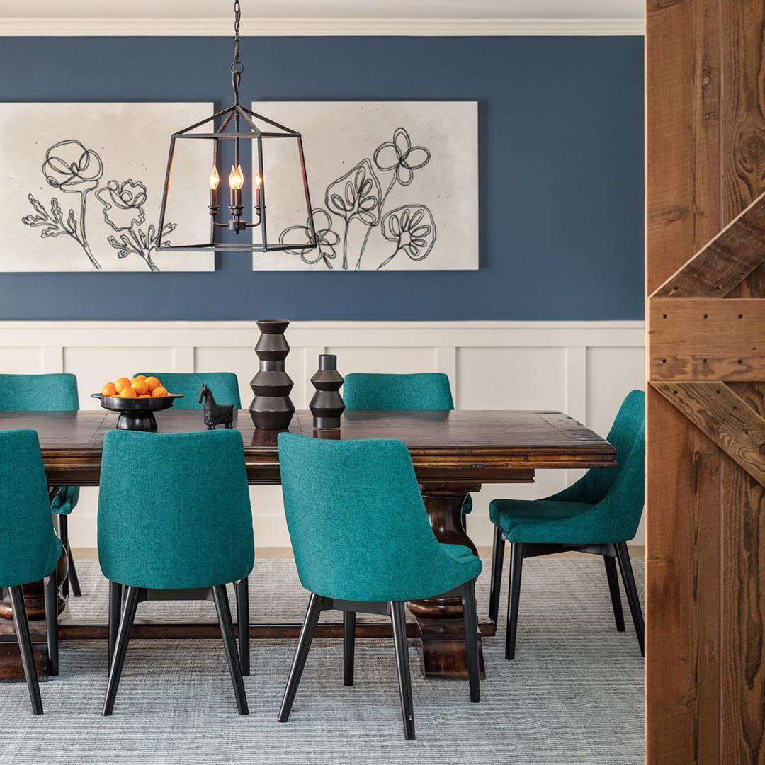 Dining room with teal chairs