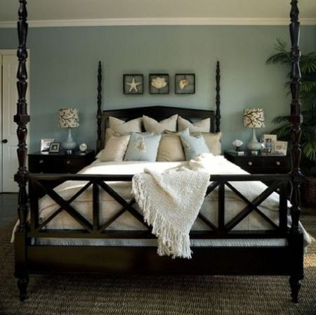 Dark Furniture In A Beach Bedroom