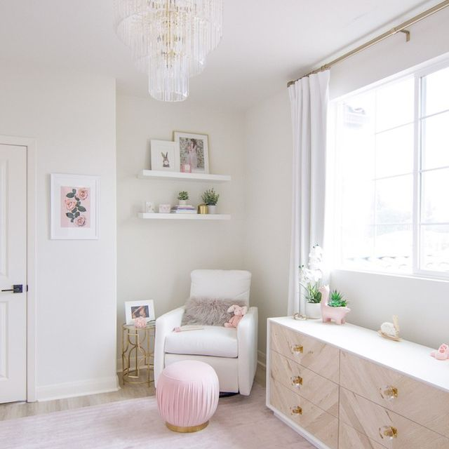 Nursery with pink rug and white chair