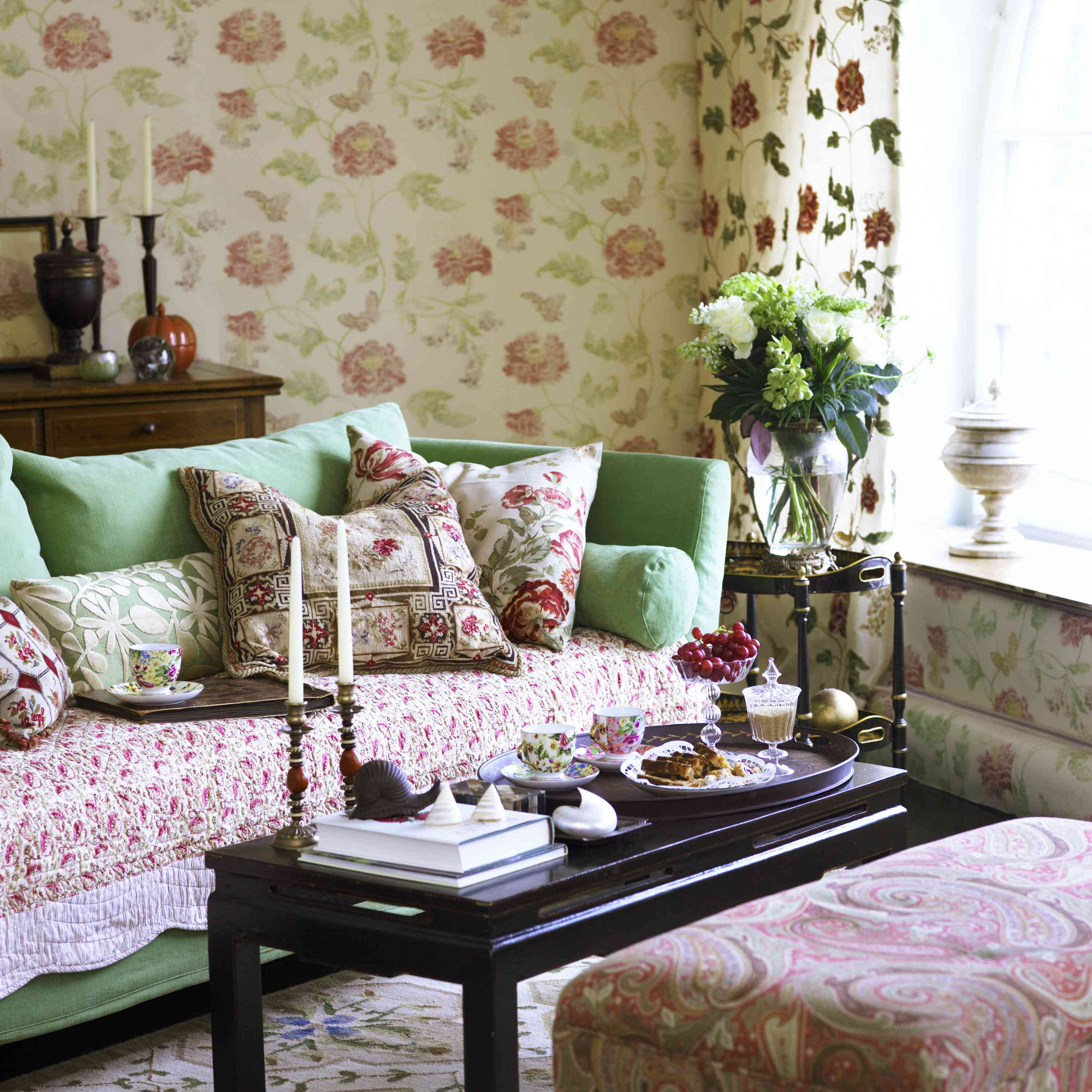 granny chic room with floral rose wallpaper and seafoam green couch