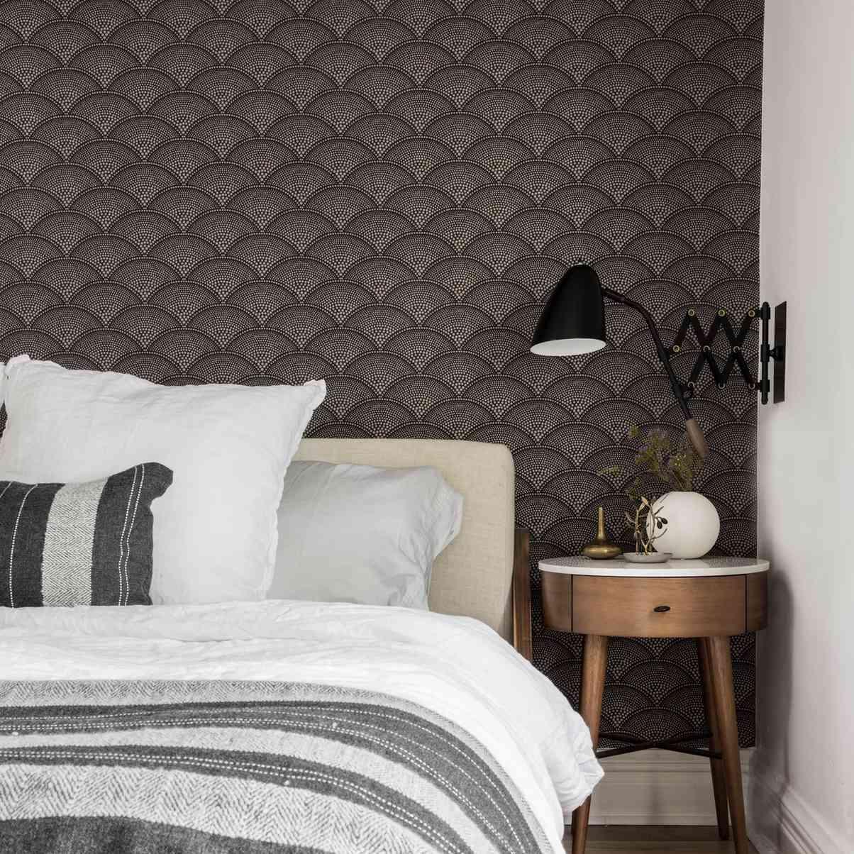 bedroom with brown half circle geometric wallpaper