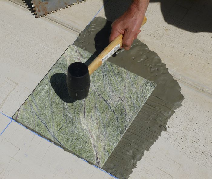 Tapping tile with a rubber mallet