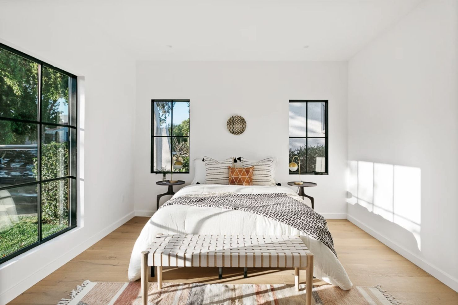 Spanish modern with white walls, windows without curtains. mediterranean vibes