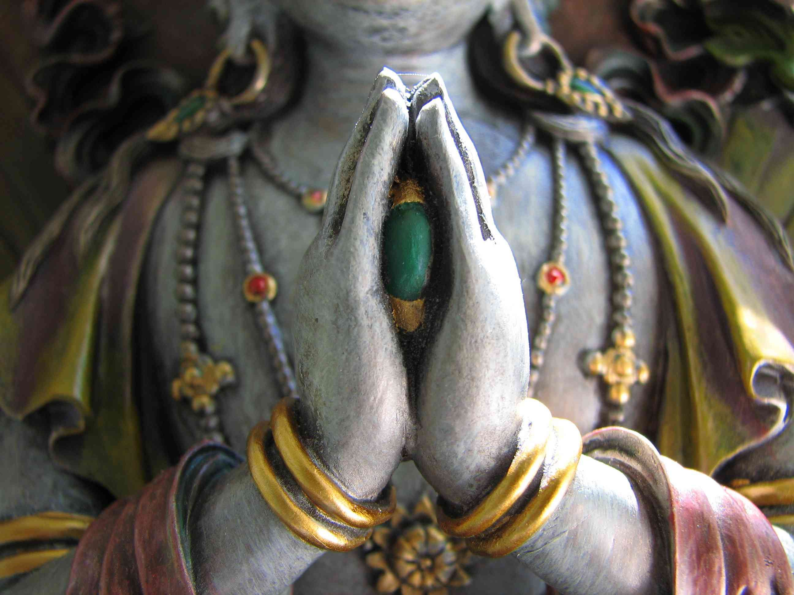Avalokiteshvara is the Bodhisattva of Compassion. In his 4-armed manifestation, he holds the Wish-Fulfilling Jewel between his palms as he meditates on liberation for all beings. In his female form, he is Tara or Kwan Yin.