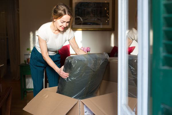 Woman unpacking a new piece of furniture