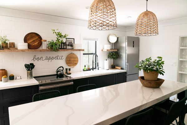 Modern farmhouse kitchen with marble countertops and wooden decor features