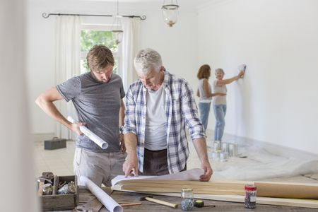 remodeling a house where to start small group of people renovating home how to organize your house renovation