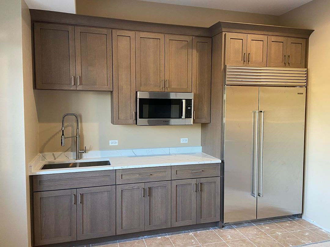 Cabinets in a kitchen with gray stain