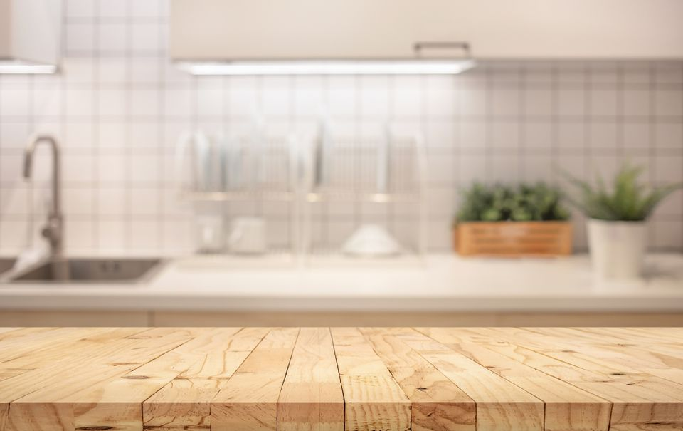 Wooden food prep table in kitchen