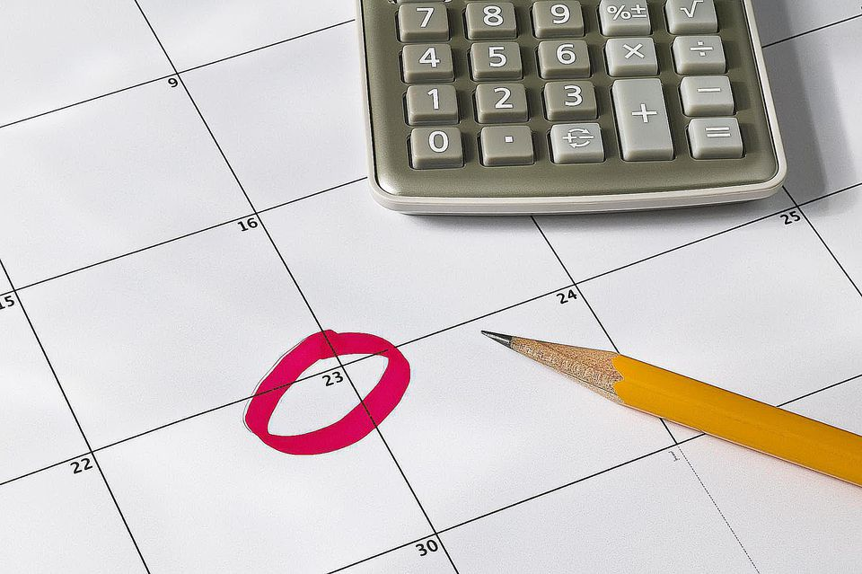 Calculator, calender and pencil