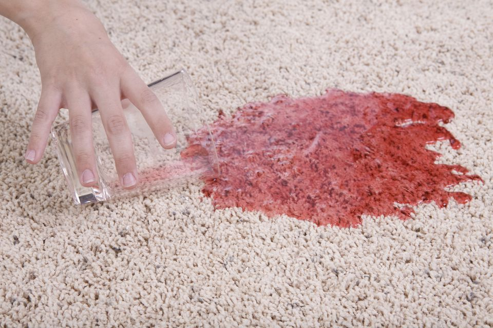 Red juice spill on a carpet