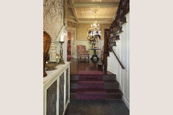 Victorian hallway with a chandelier and a security lamp