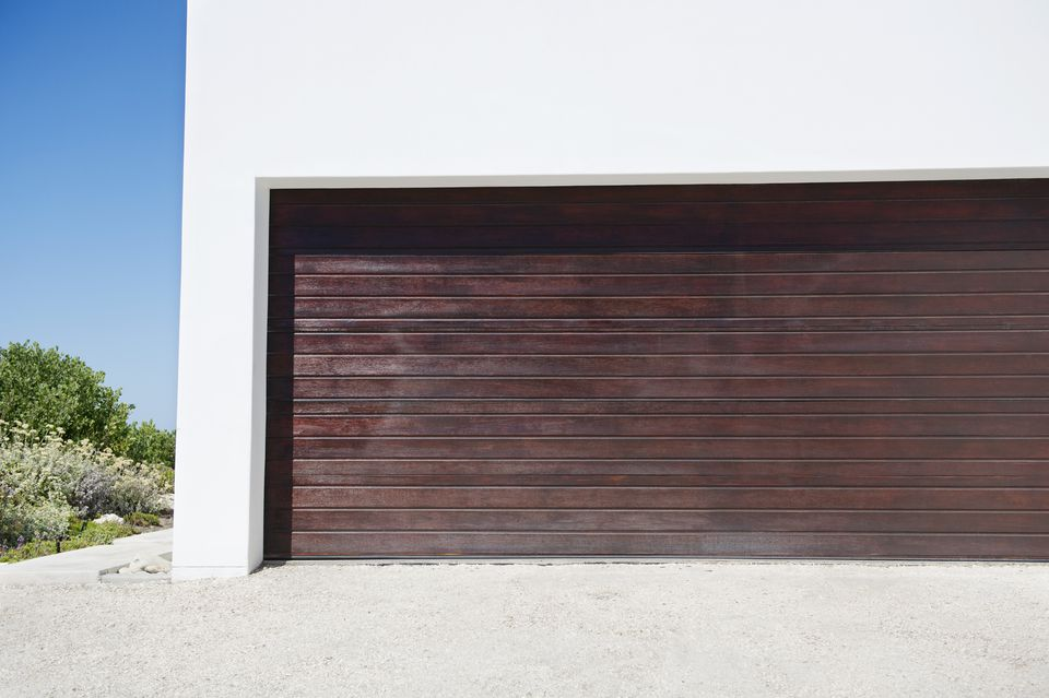 Closed wooden door of a garage