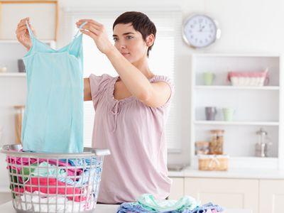 Woman folding clothes