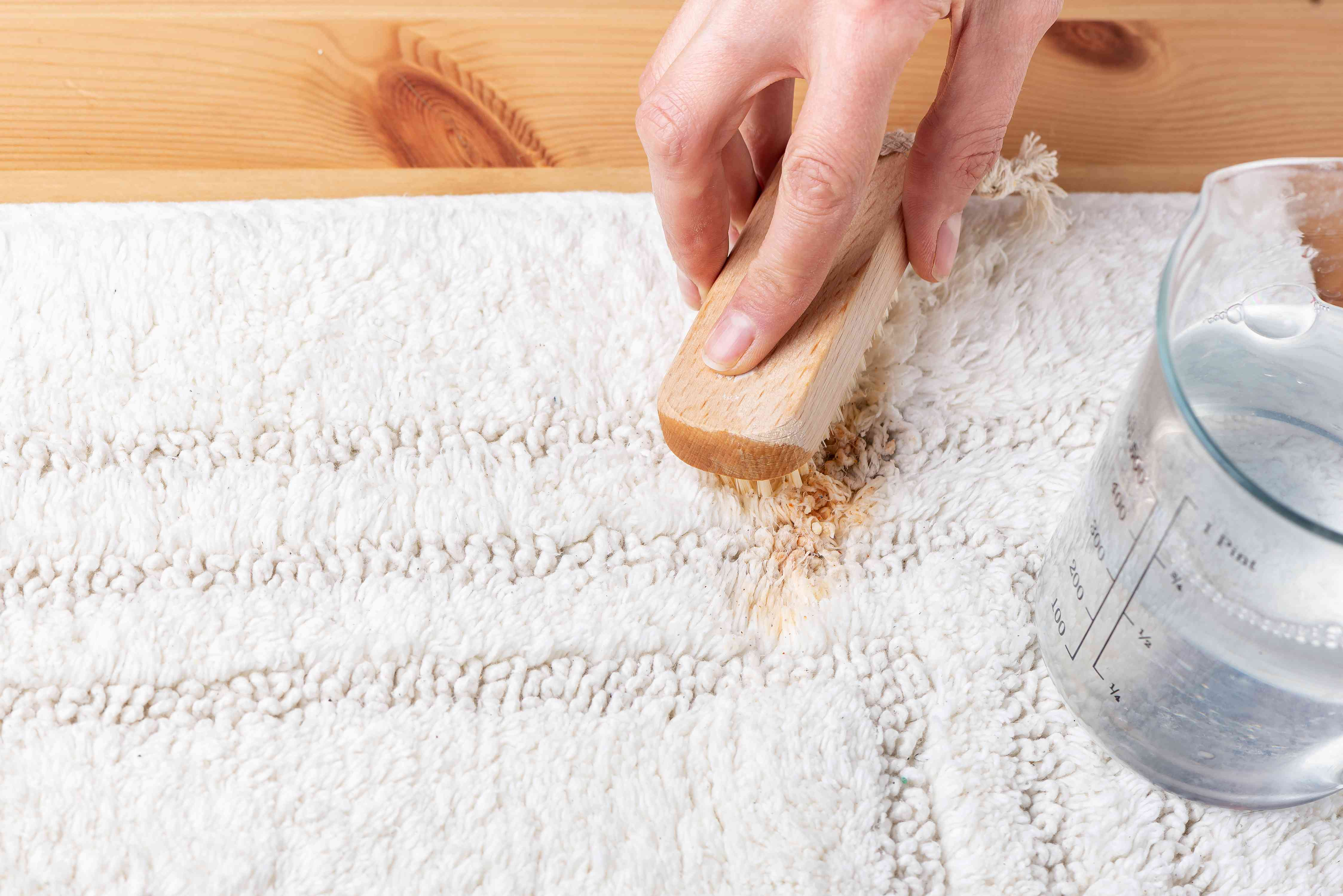 treating the stain with cleaning solution