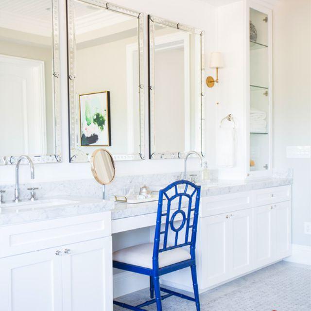 Navy chair in stark white bathroom