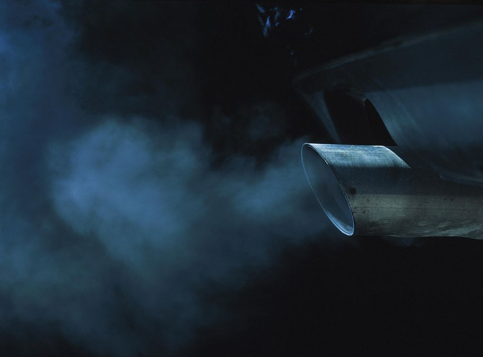 An exhaust pipe of a car emitting fumes