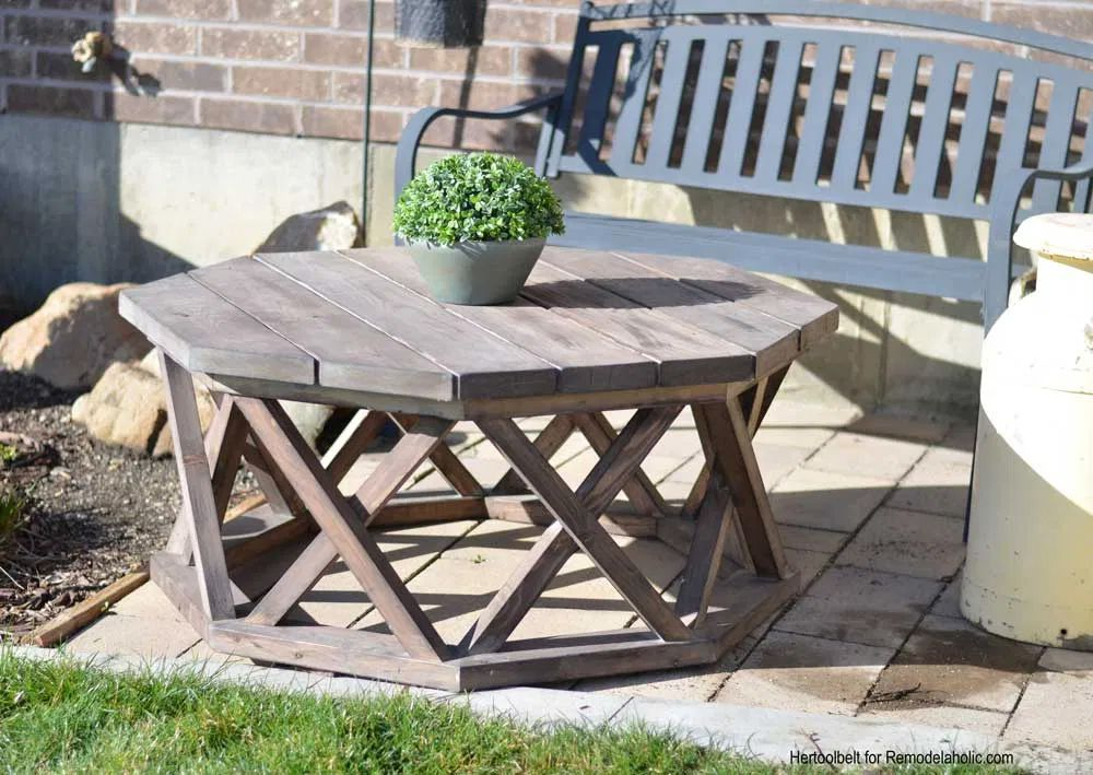 An octagon coffee table sitting outside