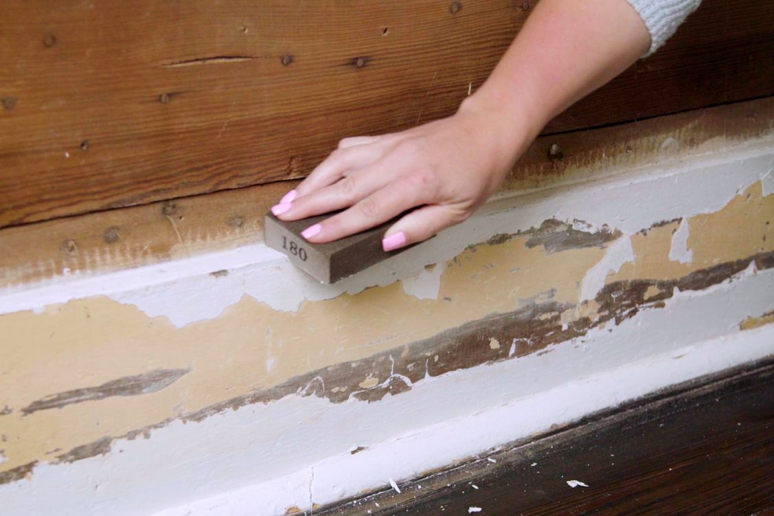 Baseboards lightly sanded by hand before painting