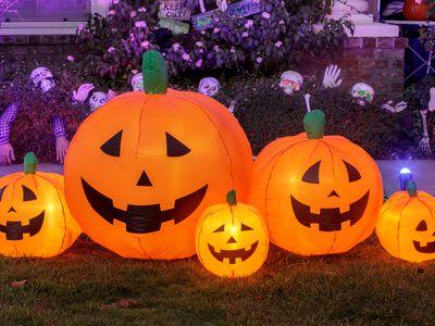 Inflatable yard pumpkins for Halloween glowing