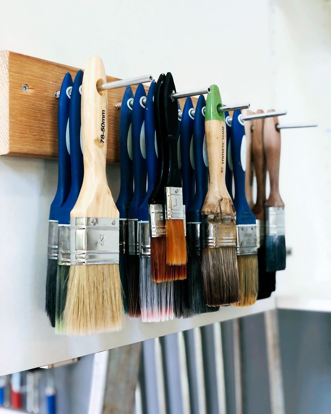 Hanging brushes on wood and nails