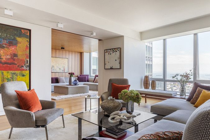 artwork and bright windows in living room