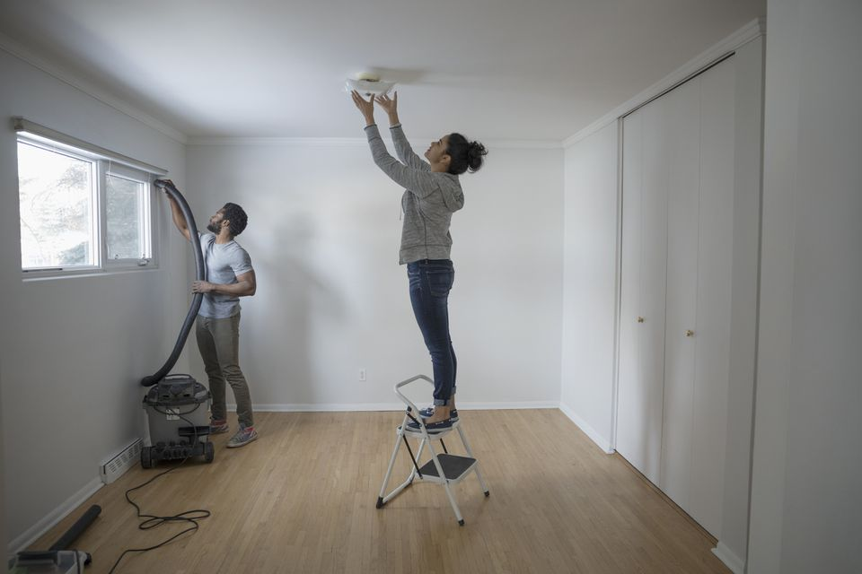 Young couple cleaning apartment