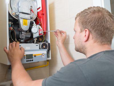 man repairing garage heater