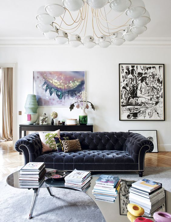 Living room with a black chesterfield sofa