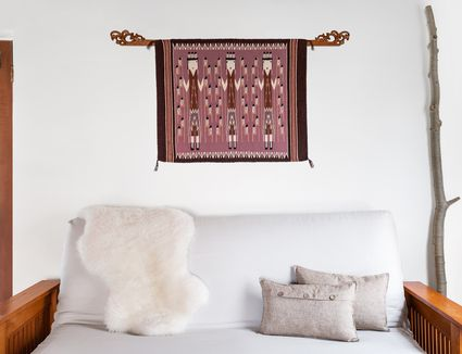 a rug mounted as artwork