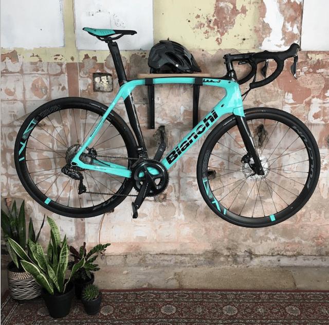 a mounted bike shelf against a brick wall