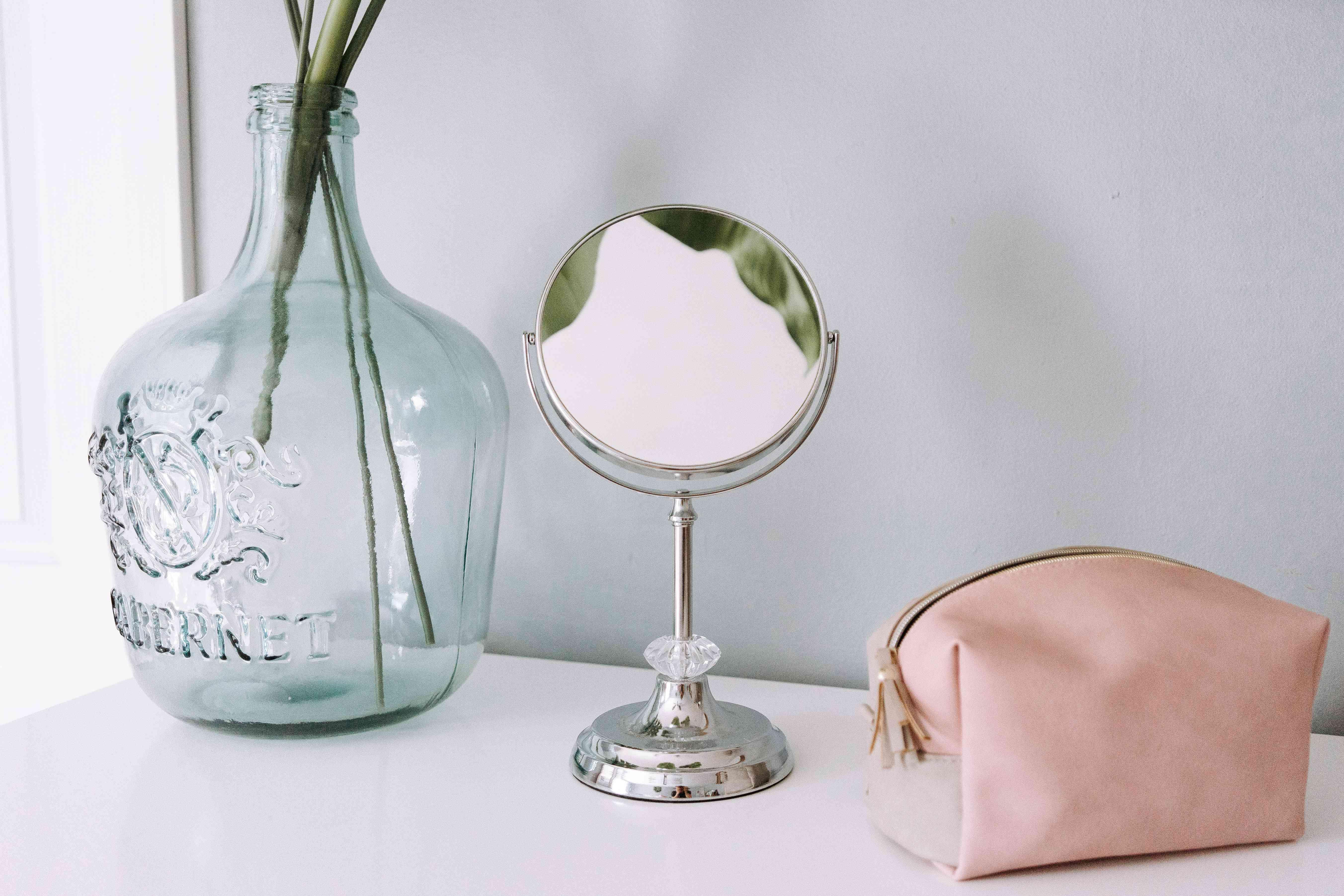 makeup mirror and bag