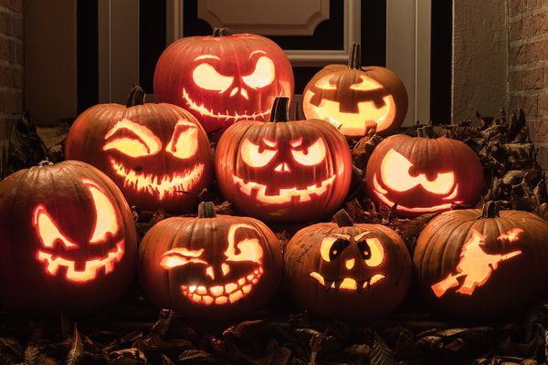 Carved pumpkins sitting on a porch